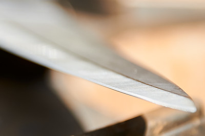 The blade of one of the knives used to slit the throats of the chickens during processing at  Gnome Mountain Farms in Franklin, North Carolina, Sunday, June 27, 2021. (Joseph Forzano / Deep Creek Films)