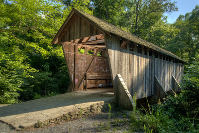The Pisgah Covered Bridge, located just off Pisgah Covered Bridge Road in the Uwharrie National Forest in Asheboro, NC on Saturday, July 5, 2014. Copyright 2014 Jason Barnette  Pisgah Covered Bridge was built in 1911 at a whopping cost of $40. It is one of only two remaining historic covered bridges in the state, the other being Bunker Hill Covered Bridge in Claremont.