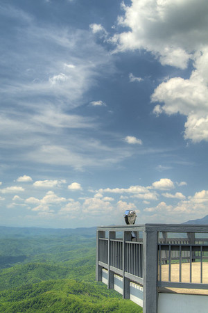 The observation deck stands high above the trees below at The Blowing Rock in Blowing Rock, NC on Wednesday, May 6, 2015. Copyright 2015 Jason Barnette  The Blowing Rock is an attraction situated on the site of the namesake for the town. Visitors can view and even climb the rock while reading about the local legend of a love story that ended with a Cherokee brave jumping from the overhanging rock, only to be thrust back on top by an upward blowing wind.