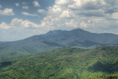 View of the distant Grandfather Mountain at The Blowing Rock in Blowing Rock, NC on Wednesday, May 6, 2015. Copyright 2015 Jason Barnette  The Blowing Rock is an attraction situated on the site of the namesake for the town. Visitors can view and even climb the rock while reading about the local legend of a love story that ended with a Cherokee brave jumping from the overhanging rock, only to be thrust back on top by an upward blowing wind.