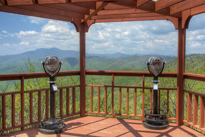 A gazebo view as visitors explore The Blowing Rock in Blowing Rock, NC on Wednesday, May 6, 2015. Copyright 2015 Jason Barnette  The Blowing Rock is an attraction situated on the site of the namesake for the town. Visitors can view and even climb the rock while reading about the local legend of a love story that ended with a Cherokee brave jumping from the overhanging rock, only to be thrust back on top by an upward blowing wind.