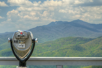 View of the distant Grandfather Mountain from the observation deck at The Blowing Rock in Blowing Rock, NC on Wednesday, May 6, 2015. Copyright 2015 Jason Barnette  The Blowing Rock is an attraction situated on the site of the namesake for the town. Visitors can view and even climb the rock while reading about the local legend of a love story that ended with a Cherokee brave jumping from the overhanging rock, only to be thrust back on top by an upward blowing wind.