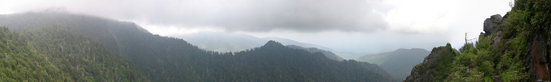 A 180 degree panorama taken from the ledge out to the Bunion, centered roughly on west.  At left is the ridge carrying the AT from Mt. Kephart, then Mt. LeConte at center (behind) and nearby ridges, then the Bunion itself at right (with a coulple of French tourists having lunch) and the trail.