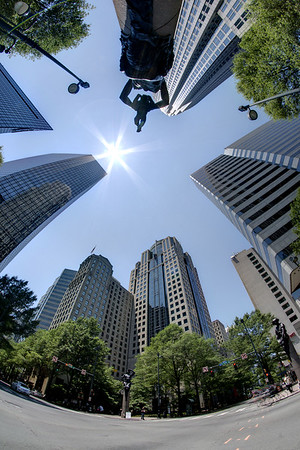 The mid-day sun beams down on the skyscrapers in Uptown Charlotte, NC on Sunday, June 15, 2014. Copyright 2014 Jason Barnette