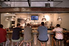 People enjoy some craft brewed beer on tap while watching a soccer game at Good Bottle Co. in Charlotte, NC on Sunday, June 15, 2014. Copyright 2014 Jason Barnette