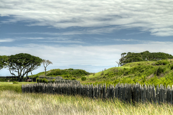 Wavy grasses surround the earthen fort at the Fort Fisher State Historic Area in Kure Beach, NC on Saturday, July 12, 2014. Copyright 2014 Jason Barnette