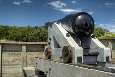 A large canon overlooking the top of the earthen fort at the Fort Fisher State Historic Area in Kure Beach, NC on Saturday, July 12, 2014. Copyright 2014 Jason Barnette