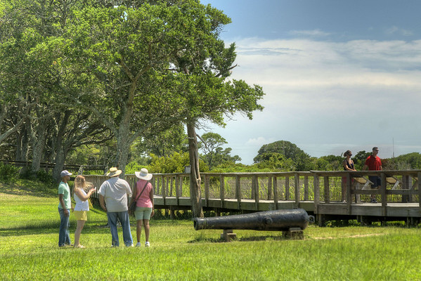 Families explore the wide open areas of the Fort Fisher State Historic Area in Kure Beach, NC on Saturday, July 12, 2014. Copyright 2014 Jason Barnette