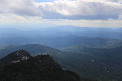 The top of the Grandfather Mountain attraction, with the Black Mountains on the horizon, as seen from the summit of McRae Peak.