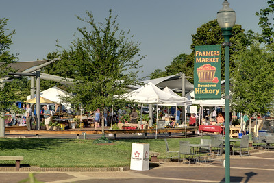 Dozens of white tents for the Hickory Farmers' Market are set up under and around the Sails on the Square in downtown Hickory, NC on Saturday, June 14, 2014. Copyright 2014 Jason Barnette