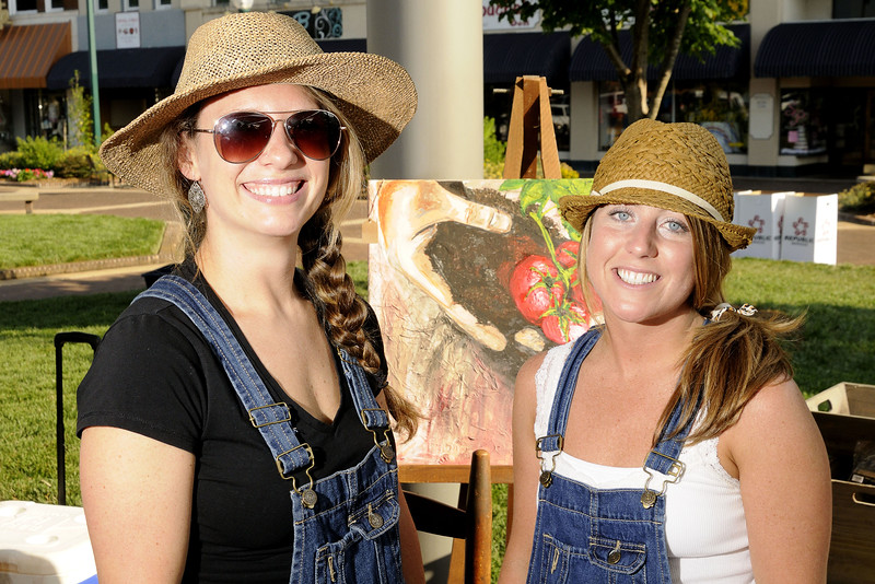 Danelle Kiziah and Natalie Hayes, artists and owners of South Main Studio, pose for a photo while selling art at the Hickory Farmers' Market at the Sails on the Square in downtown Hickory, NC on Saturday, June 14, 2014. Copyright 2014 Jason Barnette