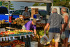 People shop for locally-made foods, locally-grown produce, and locally-crafted art at the Hickory Farmers' Market at the Sails on the Square in downtown Hickory, NC on Saturday, June 14, 2014. Copyright 2014 Jason Barnette