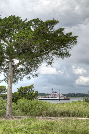 A North Carolina Ferry moves across the Cape Fear River at the Fort Fisher State Recreation Area on the southern tip of Pleasure Island in Kure Beach, NC on Saturday, July 12, 2014. Copyright 2014 Jason Barnette