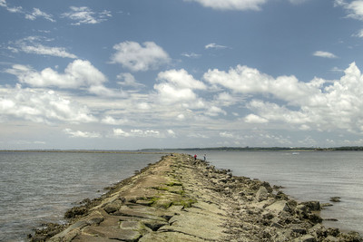 The view from The Rocks, a seawall built in the late 1800s to prevent erosion into the Cape Fear River, at the Fort Fisher State Recreation Area on the southern tip of Pleasure Island in Kure Beach, NC on Saturday, July 12, 2014. Copyright 2014 Jason Barnette