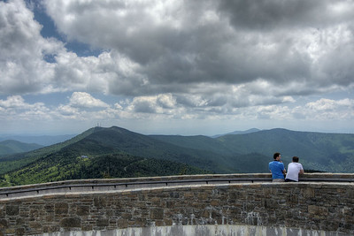 Two visitors enjoy the view from the curving ramp leading up to the observation deck in Mount Mitchell State Park at Milepost 355.4 on the Blue Ridge Parkway in NC on Saturday, June 15, 2013. Copyright 2013 Jason Barnette