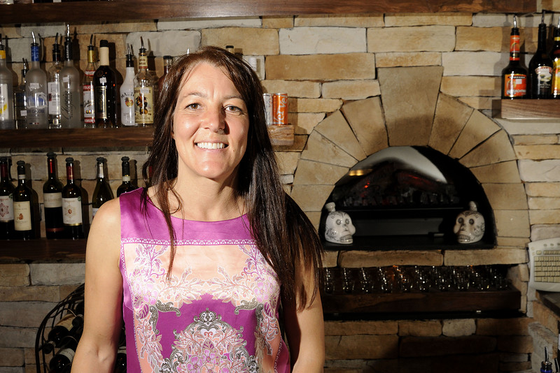 Co-owner poses for a photo behind the bar at Branciforte's Italian Ristorante on Main Street in Downtown North Wilkesboro, NC on Friday, June 13, 2014. Copyright 2014 Jason Barnette