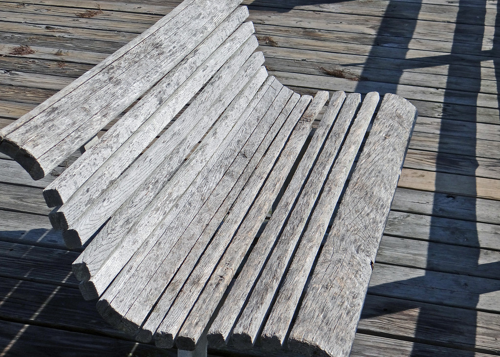 Old weathered bench on Nags Head Pier