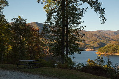 Fontana Lake from the south shore.  The Shuckstack Mountain Fire Tower is visible in a small gap between the trees on the left side of the image.