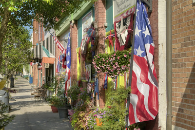 American flags and bunting decorate most of the businesses during the North Carolina 4th of July Festival in Southport, NC on Saturday, July 4, 2015. Copyright 2015 Jason Barnette