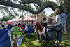 Several dozen people enjoy the shade provided by an enormous oak tree during the USCIS Naturalization Ceremony during the North Carolina 4th of July Festival in Southport, NC on Friday, July 3, 2015. Copyright 2015 Jason Barnette