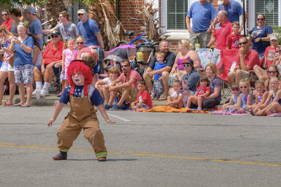 A little boy puts on some dance moves at the parade on North Howe Street during the North Carolina 4th of July Festival in Southport, NC on Saturday, July 4, 2015. Copyright 2015 Jason Barnette