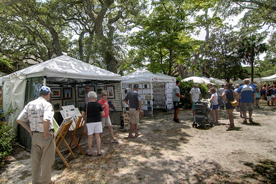 People shop among the various arts, crafts, and food vendors at Franklin Square Park during the North Carolina 4th of July Festival in Southport, NC on Friday, July 3, 2015. Copyright 2015 Jason Barnette