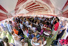 Families, friends, and spectators gather in and around a massive flag tent during the USCIS Naturalization Ceremony during the North Carolina 4th of July Festival in Southport, NC on Friday, July 3, 2015. Copyright 2015 Jason Barnette