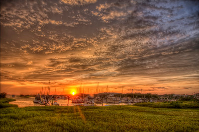 The last glance of sunlight at the end of the day at the Marshwalk in Southport, NC on Friday, June 24, 2016. Copyright 2016 Jason Barnette