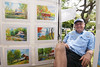 Local artist Roger Tatum poses with a collection of his original watercolor paintings at his booth in Franklin Square Park during the North Carolina 4th of July Festival in Southport, NC on Friday, July 3, 2015. Copyright 2015 Jason Barnette