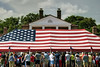 Hundreds of people gather around a massive flag tent for the USCIS Naturalization Ceremony during the North Carolina 4th of July Festival in Southport, NC on Friday, July 3, 2015. Copyright 2015 Jason Barnette