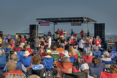 People enjoy live music from the waterfront stage during the North Carolina 4th of July Festival in Southport, NC on Saturday, July 4, 2015. Copyright 2015 Jason Barnette