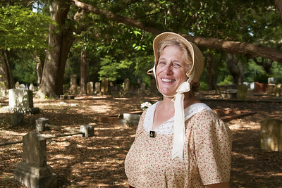 Martha Johnson poses in her period attire at the Voices From the Past reenactment event at the Old Smithville Burying Grounds during the North Carolina 4th of July Festival in Southport, NC on Saturday, July 4, 2015. Copyright 2015 Jason Barnette