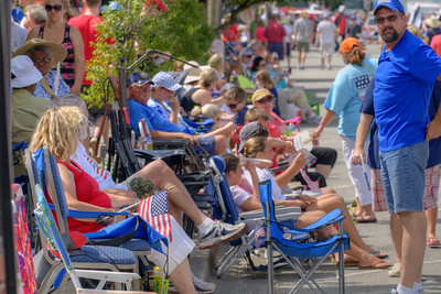People sit comfortably in their portable chairs waiting for the parade to begin along North Howe Street during the North Carolina 4th of July Festival in Southport, NC on Saturday, July 4, 2015. Copyright 2015 Jason Barnette
