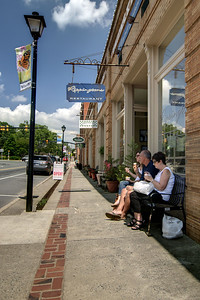 A family enjoys ice cream on Main Street in Waxhaw, NC on Saturday, June 14, 2014. Copyright 2014 Jason Barnette