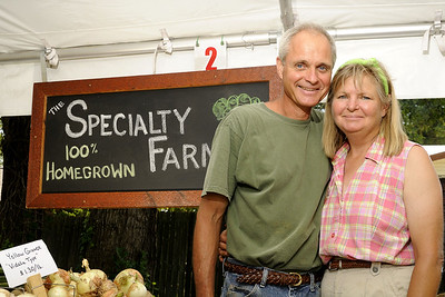 Bill and Donna Makuch, owners of The Specialty Farmer, pose for a photo during the Waxhaw Farmers' Market in Waxhaw, NC on Saturday, June 14, 2014. Copyright 2014 Jason Barnette
