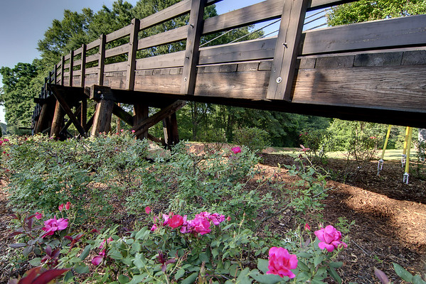 A wooden footbridge crosses some railroad tracks along Main Street in Waxhaw, NC on Saturday, June 14, 2014. Copyright 2014 Jason Barnette