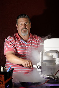 Jim Barker prepares some instant ice cream using liquid nitrogen at JB's Frozen Gold on Main Street in Waxhaw, NC on Saturday, June 14, 2014. Copyright 2014 Jason Barnette