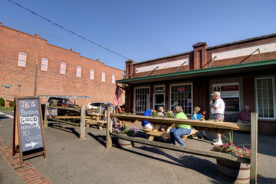 People enjoy some instant ice cream outside JB's Frozen Gold on Main Street in Waxhaw, NC on Saturday, June 14, 2014. Copyright 2014 Jason Barnette