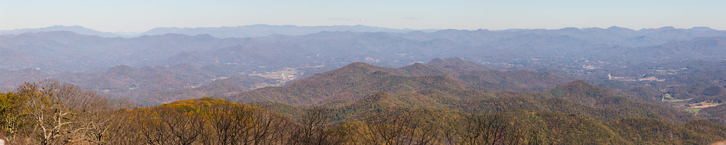 View east from the Wayah Bald observation tower.  The Franklin airport is center-left and Franklin is to the middle-distance right.  The Cowee Mountains are the nearer ridge on the horizon, with Balsam Gap behind, separating the Plott Balsams at back-left from the Great Balsams at back-center.