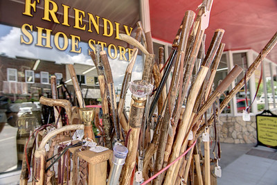 A collection of walking sticks, for both adults and children, outside the Friendly Shoe Store on Jefferson Street in West Jefferson, NC on Friday, June 13, 2014. Copyright 2014 Jason Barnette