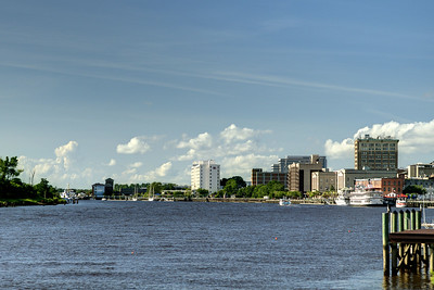 A view along the Cape Fear River of the historic downtown district from Dram Tree Park in Wilmington, NC on Sunday, July 13, 2014. Copyright 2014 Jason Barnette