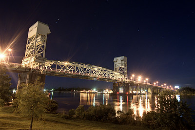 The Cape Fear Memorial Bridge lit up at night across the Cape Fear River at Dram Tree Park in Wilmington, NC on Sunday, July 13, 2014. Copyright 2014 Jason Barnette