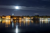 A nearly full moon (waning gibbous 99%) rises over the downtown historic district and Cape Fear River in Wilmington, NC on Sunday, July 13, 2014. Copyright 2014 Jason Barnette