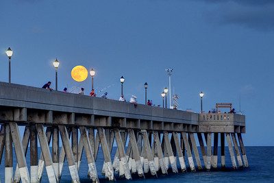The Supermoon rises over the Johnnie Mercer's Fishing Pier in Wrightsville Beach, NC on Saturday, July 12, 2014. Copyright 2014 Jason Barnette