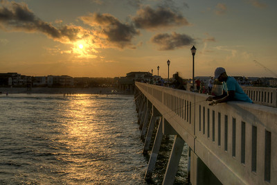 People fish during sunset from the concrete Johnnie Mercer's Fishing Pier in Wrightsville Beach, NC on Saturday, July 12, 2014. Copyright 2014 Jason Barnette