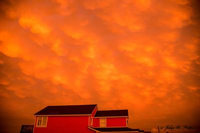 Orange clouds over beach house.