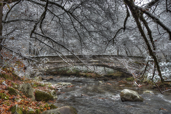 One of the bridges in the Smokemont Campground in the Great Smoky Mountains National Park. While camping there it snowed about three inches on us over the night.  Needless to say we awoke to a wintery wonderland of white.
