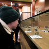 The area's first pot dispensary Sanctuary Medicinals in Gardner held its official ribbon cutting on January 4, 2019. Courtney Tanner and Employee in Sancturay's Littleton office looks over the products that where for sale in the Gardner shop. SENTINEL & ENTERPRISE/JOHN LOVE