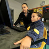 """The holidays are over and the """"Girls Who Code"""" class was back in full swing at the Boys and Girls Club of Fitchburg and Leominster Saturday, January 5, 2019. Instructor Josie Rivera helps Amelia Carboni, 9, during class on Saturday. SENTINEL & ENTERPRISE/JOHN LOVE"""