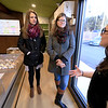 The area's first pot dispensary Sanctuary Medicinals in Gardner held its official ribbon cutting on January 4, 2019. Gardner City Councilor Lizzy Kazinskas, on left, and her sister Stacey Kazinskas, a board member of the Greater Gardner Chamber of Commerce, listen to Acting Dispensary Manager Forest Steinberg, on right, as she informs them all about their shop and what they sell. SENTINEL & ENTERPRISE/JOHN LOVE